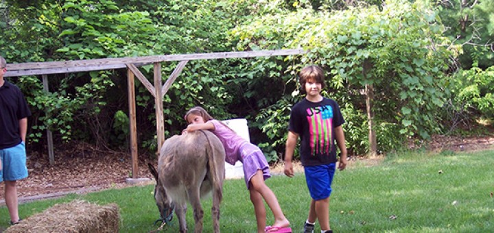 Lydian and Rylie with donkey