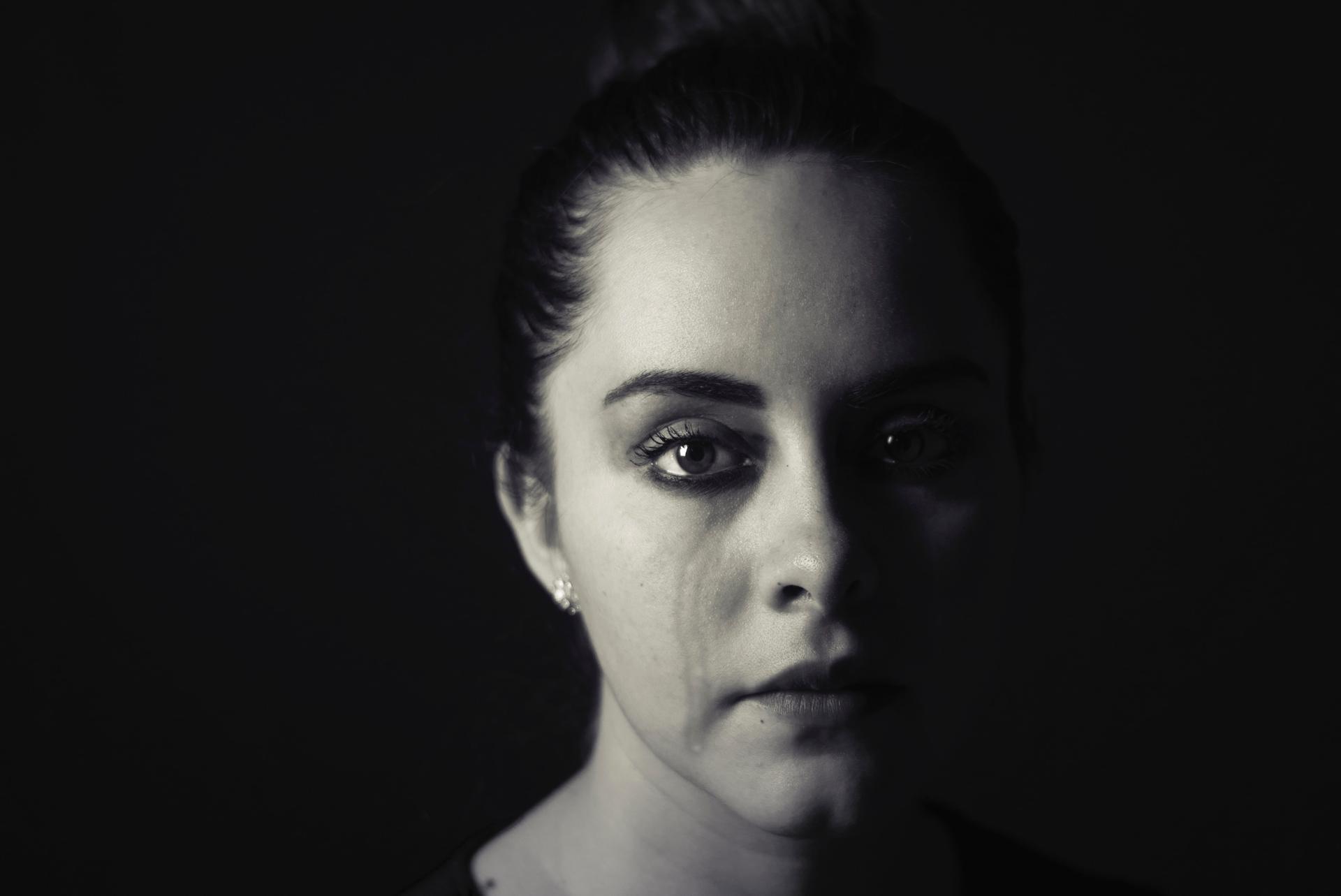 woman's face with tear