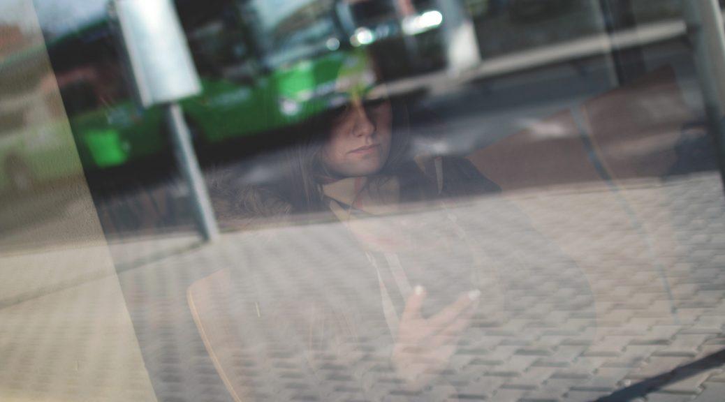 woman in window on phone